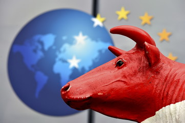 Head of a cow statue is seen in front of a European logo as farmers and dairy farmers from all over Europe take part in a demonstration outside a European Union farm ministers' emergency meeting at the EU Council headquarters in Brussels, Belgium