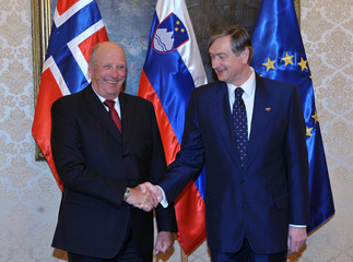 Slovenia's President Danilo Turk welcomes Norway's King Harald V during his visit to Brdo