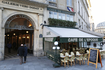 Visitors enter the Galerie Verot-Dorat which houses shops, art galleries, restaurants, and fashion boutiques in Paris