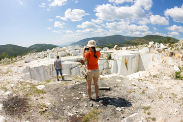 Tourists are photographed in the old abandoned marble quarry