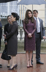 Peng Liyuan, the wife of China's President Xi Jinping, stands with Britain's Catherine, Duchess of Cambridge, at Lancaster House in London