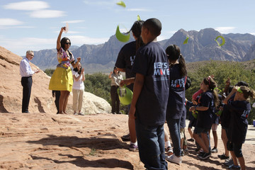 Senate Majority Leader Reid (D-Nev.), First Lady Obama and Assistant Secretary of the Interior Suh cheer with children near Las Vegas