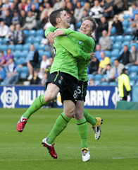 Celtic's Commons celebrates with his team mate Hooper after scoring against Kilmarnock during their Scottish Premier League soccer match in Kilmarnock, Scotland