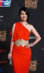 Hong Kong singer and actress Yeung poses on the red carpet during the Mnet Asian Music Awards in Hong Kong