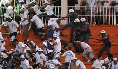 Police clash with Santos fans during a Brazilian championship soccer match between Santos and Corinthians in Sao Paulo