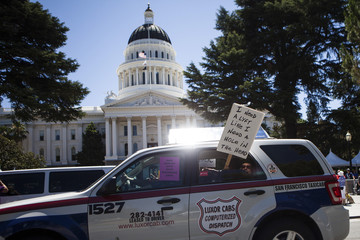 Taxi drivers protest against transportation network companies such as Uber and Lyft along with Assembly Bill 2293 at the State Capitol in Sacramento