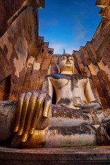 Seated Buddha image at  Wat Si Chum temple in Sukhothai  Historical Park, a UNESCO world heritage site, Thailand