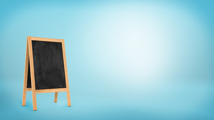 A blank chalkboard stand with a wooden frame on blue background.