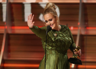 "Adele and co-song writer Kurstin accept the Grammy for Song of the Year for ""Hello"" at the 59th Annual Grammy Awards in Los Angeles"