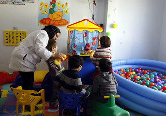Autistic children play at the Consulting Centre for Autism in Amman