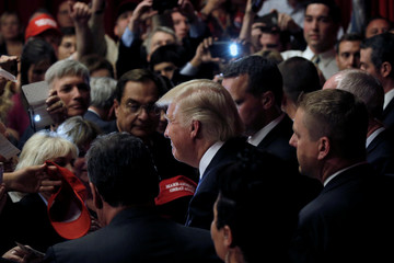 U.S. Republican presidential candidate Donald Trump and New Jersey Governor Chris Christie greet supporters at a fundraising event in Lawrenceville