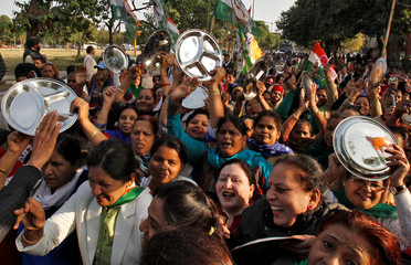 Women carrying kitchen utensils shout slogans during a protest organised by India's main opposition Congress party against demonetization in Chandigarh