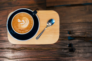 A cup of coffee cup on a wooden table