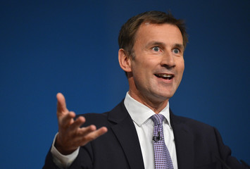 Britain's Health Secretary Hunt delivers his keynote speech at the Conservative Party conference in Birmingham, central England