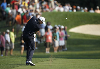 Watney of the U.S. hits his approach to the 12th green during the AT&T National golf tournament in Bethesda