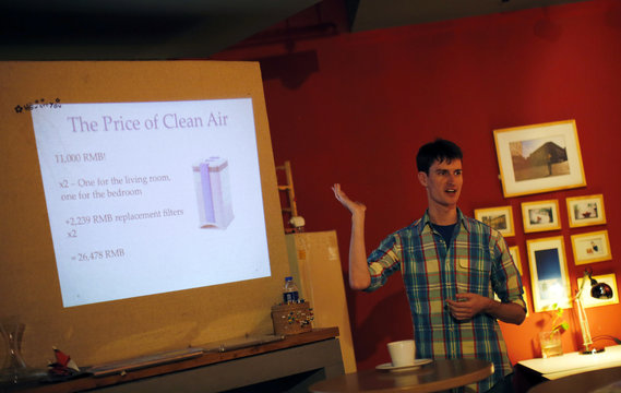 Gus Tate talks during a workshop organized by Smart Air Filters at a local coffee shop in Shanghai