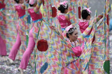 Dancers perform during Taiwan's National Day celebrations in front of the Presidential Office in Taipei