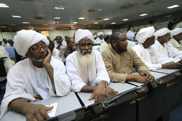 Misseriya tribesmen listen to the members of the Misseriya delegation to Addis Ababa for talks on the disputed Abyei oil region speak during a news conference in Khartoum