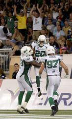 Roughriders' Maze celebrates his interception touchdown during the second half of their CFL football game against the Blue Bombers in Winnipeg