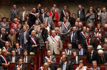 French Socialist party deputies react during a session at the National Assembly in Paris