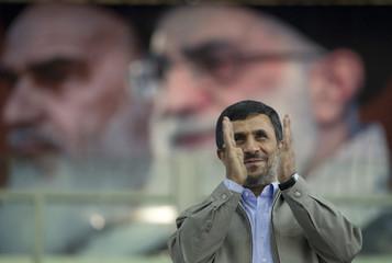 Iranian President Mahmoud Ahmadinejad responds to applause in Tehran