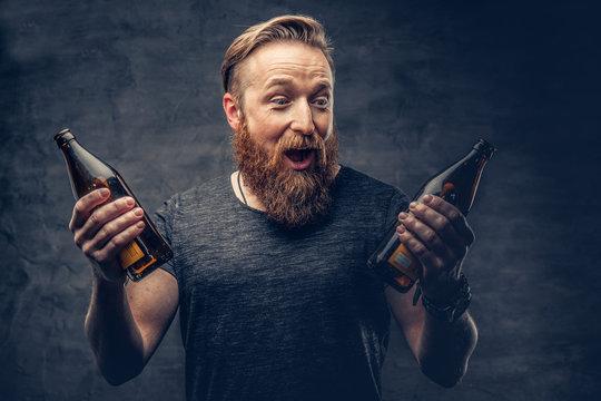 A man holds beer bottle.