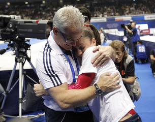 Jordyn Wieber  of the U.S. hugs with her head Coach John Geddert after winning the women's individual all-around final at the Artistic Gymnastics World Championships in Tokyo
