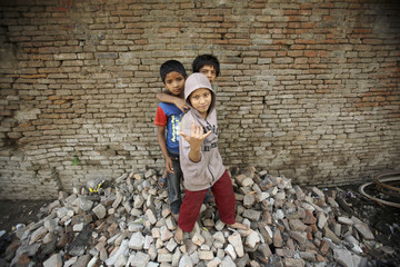 Homeless children pose in front of the camera in Kathmandu