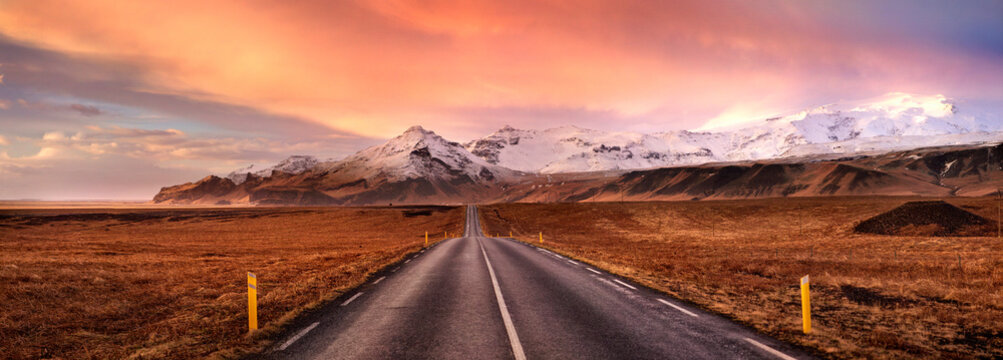 Horizon road and the snow covered mountains, Iceland