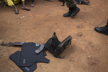 AK-47 assault rifle with a magazine of ammunition, a bag of grenades and a flak jacket are seen on ground after AU peacekeepers found them during search and disarmament operation in Kilometre 9 in capital Bangui