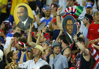 Fans of the U.S. hold up pictures of Martin Luther King Jr and Barak Obama before World Cup soccer match between Ghana and the U.S. at Dunas arena