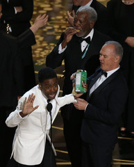 Actors Freeman and Keaton enjoy Girl Scout cookies as host Rock closes the show at the 88th Academy Awards in Hollywood,