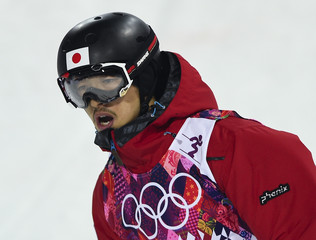 Japan's Endo reacts in the finish line of the men's freestyle skiing moguls finals at the 2014 Sochi Winter Olympic Games in Rosa Khutor