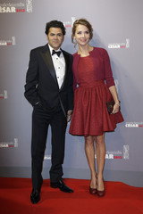 French actor and President of Ceremony Jamel Debbouze and his wife French journalist Melissa Theuriau pose as they arrive at the 38th Cesar Awards ceremony in Paris