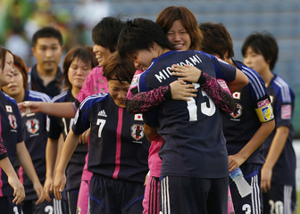 Japan's players celebrate after winning the third place match against Nigeria at the U-20 Women's World Cup in Tokyo