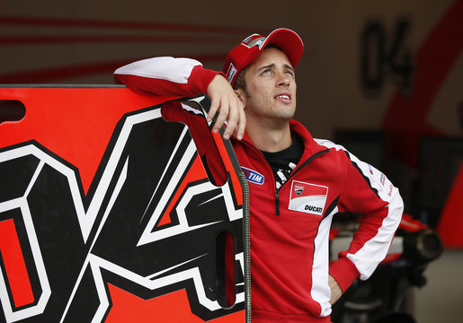Ducati MotoGP rider Dovizioso of Italy looks up into the sky from his team's garage ahead of Sunday's Japanese Grand Prix in Motegi