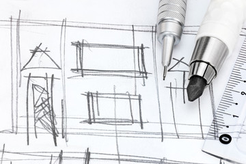 designers working place with hand drawing of living room and pencils