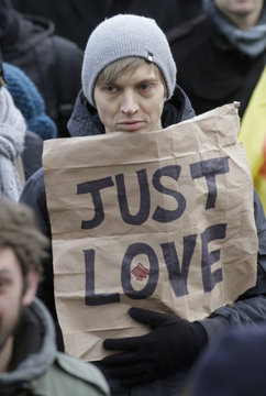A demonstrator holds a sign as some 4,000 people march in support of the French government's draft law to legalise marriage and adoption for same-sex couples in  Strasbourg