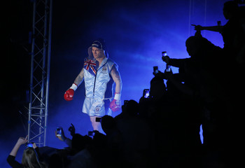 Britain's Hatton enters the ring ahead of his boxing match at the Manchester Arena with Ukraine's Senchenko  in Manchester
