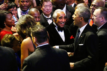 U.S. Representative Rangel smiles as President Obama and first lady Michelle Obama greet members of the audience at the Congressional Black Caucus Foundation dinner in Washington