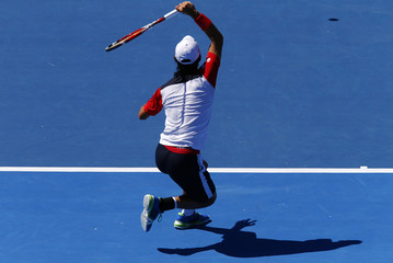 Nishikori hits a shot during the final against Berdych at the Kooyong Classic tennis tournament in Melbourne
