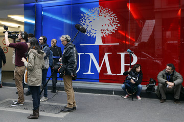 Journalists stand in front of the UMP headquarters as they wait for the result for the new leader of the UMP political party in Paris