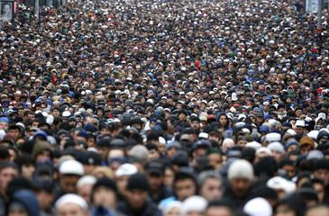 Muslims attend an Eid al-Adha mass prayer in Moscow