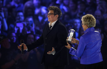 Canadian musician Lang is presented with the Juno Award to induct Lang into the Juno Hall of Fame by Murray during the Juno Awards show in Regina.
