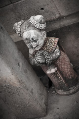 scary cemetery statue in thai style horror death