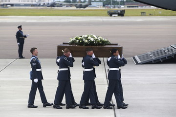 The coffin of William Graham is carried from an RAF C-17, which repatriated the bodies of nine British nationals killed by a gunman in an attack at the Tunisian beach resort of Sousse, in RAF Brize Norton