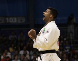 Brazil's Correa celebrates his victory over Cuba's Despaigne in their men's -100kg judo gold medal contest at the Pan American Games in Guadalajara