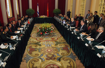 Israel's President Peres and his Vietnamese counterpart Sang talk at the Presidential Palace in Hanoi