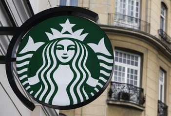 The Starbucks logo is seen outside the new Starbucks cafe in Warsaw