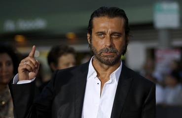 "Cast member Jordi Molla poses at the premiere of ""Riddick"" in Los Angeles"